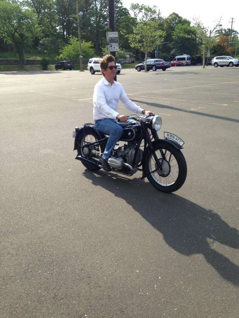 Philip riding the 1937 BMW R5 in the Greenwich train station parking lot.