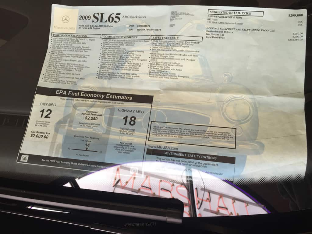 A SL 65 Black Series window sticker…yikes! Six years of great care and a lot of depreciation fall in my favor!