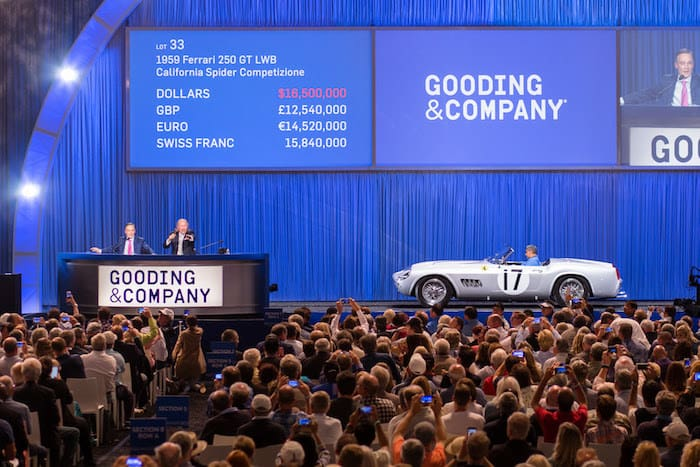 (L-R) David Gooding and Charlie Ross sell the 1959 Ferrari 250 GT LWB California Spider for $18,150,000. Image copyright and courtesy of Gooding & Company. Photo by Mike Maez.