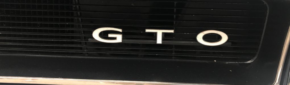 In 1965 it was unusual to have a logo or badge be offset as it is with the GTO